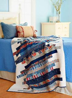 Skinny Strips Quilt - Easy & scrappy. Wouldn't this be great backed with denim or Navy chambray for your 4th of July picnic? Or as a table covering?