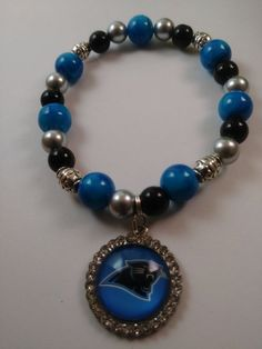 8 inch Stretch Bracelet made with 8 and 10mm beads representing the Carolina Panthers in blue, black and silver. Football Bracelet, Beaded Necklace, Beaded Bracelets, Carolina Panthers, Stretch Bracelets, Bracelet Making, Beads, Trending Outfits, Unique Jewelry