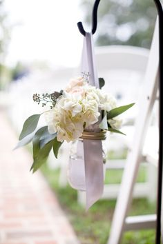 Ribbons with mason jar lids screwed on. Style Me Pretty | Gallery