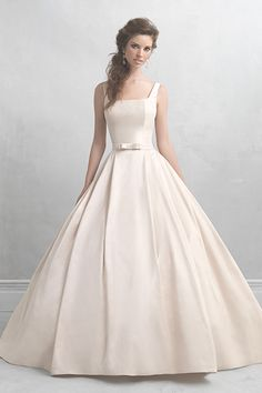 Satin ball gown with square neckline and bow accent by Madison James, $785.Check out more gorgeous dresses in our Madison James wedding gown gallery ?