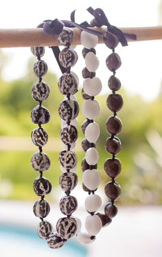 Handmade Kukui nut necklaces by beachgirlbodygoods on Etsy, $14.00