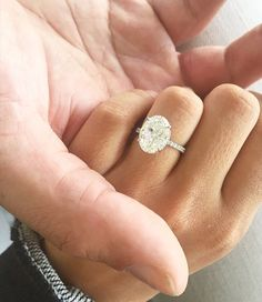 This oval solitaire engagement ring is absolutely stunning!