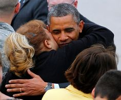 President Barack Obama hugs a guest on the tarmac after stepping off Air Force One at McGuire Air Force Base, N.J. Tuesday, May 28, 2013. (AP Photo/Rich Schultz)