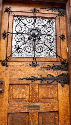 I love the metal work also the quarter-sawn oak? Philadelphia, Pennsylvania, USA- Fairmount section of Philly. Photo by Kerrins Giraffe Cool Doors, Unique Doors, La Forge, Knobs And Knockers, Iron Work, Architectural Elements, Doorway, Blacksmithing, Windows And Doors