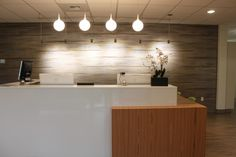 One of CrossFields latest Front Desk Designs at Bellevue Pain Institute for ChiropracticOfficeDesign.com