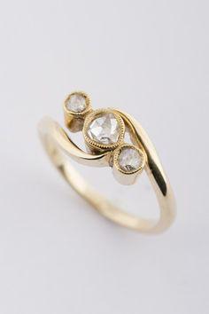 Gouden ring met roos diamanten