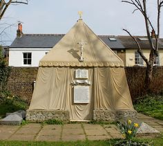 Mausoleum of Sir Richard and Lady Burton: Churchyard of St Mary Magdalen Grade II* listed. Mausoleum. c1890 in the shape of a Bedouin tent made of Carrara marble and Forest of Dean stone, 12 feet square and 18 feet high