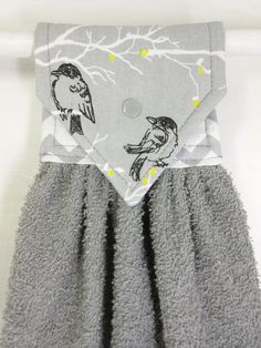 Gray hanging hand towel with little birds and a touch of yellow. The lining is gray and white chevron. Position of birds may vary. Ready to