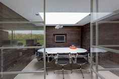 Glass modern office meeting room no people by Paul Phillips
