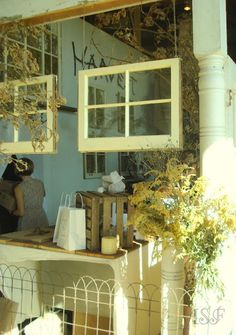 Great idea for old windows. I want to hang old windows on my front porch.