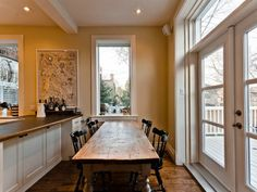 beautiful kitchen table facing a picture window