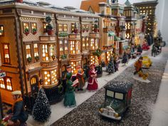 """Magnificent Christmas Village by mammabiscuit.com!! I would LOVE to have a """"downtown"""" scene to add to my village with tall apartment buildings and small businesses <3"""
