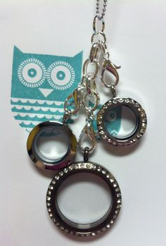 Origami Owl:  large Chocolate locket with crystals; shown with two Mini Silver lockets  Book a party or Join our team...it is so amazing!!  Sharalyn Saliger #8030 www.3hootsandaholler.origamiowl.com