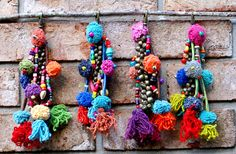Pom Pom Shaman Bells: Colorful Keychain made from silk cord, colorful pompoms, wooden beads, tassels and awesome jingle bells. Sold by each.