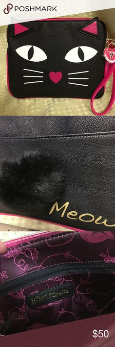 Adorable meow 🐱 clutch with fluffy tail Betsey J So cute-- Betsy Johnson kitty cat 👛 clutch- has a pink wrist handle and a black fluffy tail! Never used. Betsey Johnson Bags Clutches & Wristlets