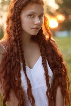Very Celtic. Wild child with red plaits