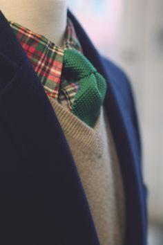 Pink/navy/green plaid shirt + green tie + navy jacket + grey V neck pullover