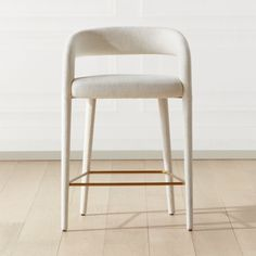 Shop Lisette White Counter Stool. Designed by fashion-designer-turned-home-designer Brett Beldock, this sculptural stool brings a bit of sophistication to any space. Updating the traditional barrel chair design, Bretts fresh take is more open and lighter in feeling.
