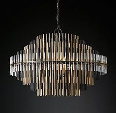 """RH Modern's Emile Chandelier 32"""":Ascending and descending concentric spires comprise the profile of our chandelier, designed by Adam Grant and inspired by a 1970s design. Multiple tiers of graduated metal and acrylic rods filter the glowing light of LEDs while lending the piece a sculptural presence."""