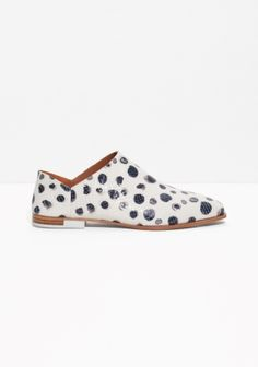 & OTHER STORIES With extended coverage on the upper and an ultra-soft heel counter, these textured leather flats with a dalmatian print are a comfortable and demurley cool interpretation of  masculine footwear.