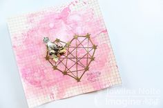 Jowilna Nolte creates a journal page with embossed diecut geometric heart and cover the page in Fireworks shimmer.