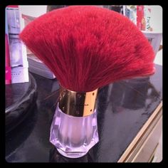 Victoria's Secret shimmer brush Victoria's Secret Rapture shimmer brush. Brush is in good condition. 50% left. Goes on your skin and gives you a soft glow. Makeup Luminizer