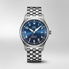 This thematic special edition of the Mark XVIII with blue dial has a compact case that unites all the functions and style cues of a typical Pilot's Watch. Stainless Steel Types, Stainless Steel Bracelet, Iwc Perpetual Calendar, Iwc Pilot, Iwc Watches, Luxury Jewelry Brands, Telling Time, Luxury Watches For Men, Boutique