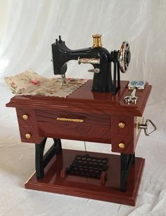 Music Box Vintage Miniature Sewing Machine NOW in 2 sizes Sewing Machines Best, Treadle Sewing Machines, Sewing Hacks, Sewing Projects, Sewing Ideas, Sewing Tips, Sewing Patterns, Ironing Pad, Craft Bags