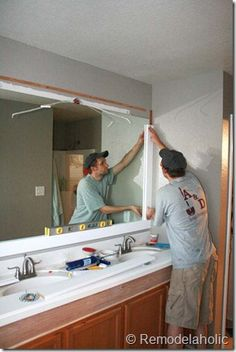Framing A Large Bathroom Mirror. Neutral paint w/small purple accents & paint frame PURPLE! So excited!