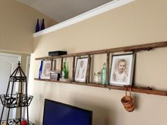 "Repurposed old wooden ladder. Used ""L"" brackets to hang away from wall. Vintage ladder reuse, wall, shelf."