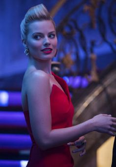 Margot Robbie in a red dress in the movie Focus