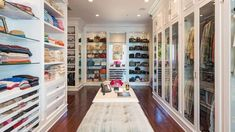 Walk In Closet With Glass Doors And Recessed Lighting : Walk In Closet Offer A Good Storage Option