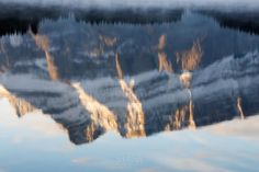 """""""Glass""""  The north face of Mt. Rundle reflected in Two Jack Lake just after sunrise.  #banff #banffnationalpark #alberta #travelalberta #parkscanada #ohcanada #canada #imagesofcanada #wildlycreative #mybanff #canadianrockies #rockies #rundle #mtrundle #twojack #twojacklake #lake #reflection #sunrise #mountain #reflections #ic_landscapes"""