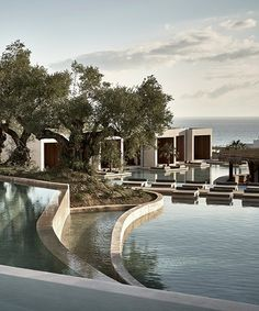 olea hotel is perched on a hill overlooking the greek island of zakynthos and combines mediterranean architecture with tropical modernism. Beach Hotels, Hotels And Resorts, Maui Hotels, Hilton Hotels, Mykonos Resort, Hotels In Charlotte Nc, Tulum, Hotel Design Architecture, Lake Hotel