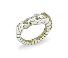 AN ENAMEL, DIAMOND AND RUBY BRACELET, BY DAVID WEBB  The white enamel articulated opening bangle designed as a horse, with cabochon ruby eyes, pavé-set diamond forehead detail and ears, holding a pavé-set diamond hoop in its mouth, joined to its tail, mounted in platinum and gold