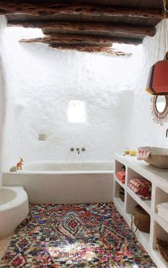 Inside the peaceful Ibiza hideaway with a higgledy-piggledy charm of its own the main bathroom features Spanish obra (built-in cement cabinets), and a lampshade by Ana Kraš Boho Bathroom, Bathroom Interior, Eclectic Bathroom, Bathroom Ideas, Budget Bathroom, Bathroom Remodeling, Bathroom Goals, Master Bathroom, Remodeling Ideas