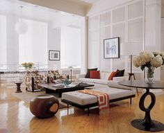 Love the legs on the chaise and the cowhide chairs
