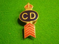 Civil Defence lapel badge with war service chevron  White metal and enamel Civil Defence badge with half moon lapel fitting. This example has the addition of 5 \' war service \' chevrons to the bottom of the badge. Enamel and frosting in good clean, undamaged condition.