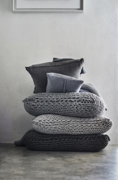 Cozy chunky sweater knits covering big comfy floor cushions...