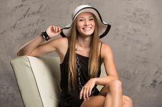 www.spokanefamilyphoto.com/senior  Senior portrait photographer.  In studio high school senior girl with hat.