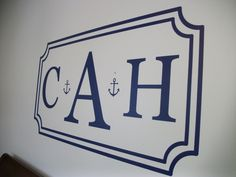 Monogrammed wall with anchors.