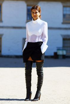 { Sheer Paneled White Blouse, Black BALENCIAGA Skirt and Studded Thigh High Black Leather Boots. }