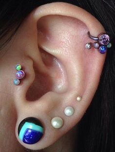 Helix and tragus piercings with opal and titanium jewelry by Anatometal (at Evolution Body Piercing) Helix Jewelry, Tragus Jewelry, Body Jewelry Piercing, Helix Earrings, Ear Jewelry, Cartilage Earrings, Body Piercing, Jewellery, Tragus Stud