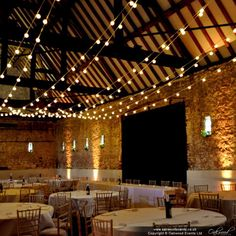 Oakwood Events Ltd, Festoon canopy and uplighting for a spring wedding in the Monks Barn Hurley