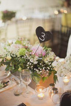 Niagara Parks Floral Showhouse Wedding Photography: Beth & Ty in Love - bethandty.com/ chalkboard heart table numbers, barn board planter box centerpiece, rustic elegant barn wedding reception  Read More: http://www.stylemepretty.com/canada-weddings/ontario/niagara-falls/2013/12/17/niagara-parks-floral-showhouse-wedding/