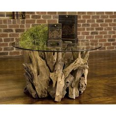 Teak driftwood and glass coffee table.
