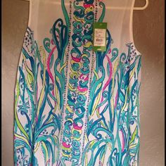 Lilly Pulitzer Iona shell Top Size Medium Love this piece!!! Never worn,brand new with Tags. Beautiful buttons down back. Size medium. Cheaper on ️. Lilly Pulitzer Tops Blouses