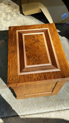 that's one way to cover up a water ring damage, just inlay with maple and walnut.