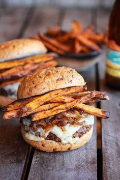 Epic Crispy Quinoa Burgers Topped with Sweet Potato Fries, Beer Caramelized Onions and Gruyere – More at http://www.GlobeTransformer.org