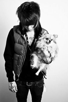 Christopher Drew, NeverShoutNever, with a puppy